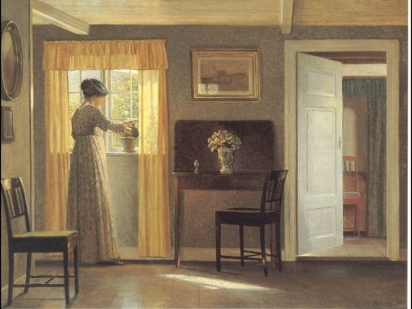 A Lady Watering A Plant By A Window